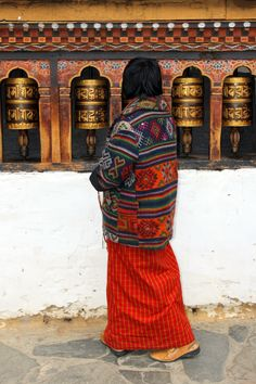 Prayer Wheels in Tibet. A prayer wheel is a cylindrical wheel on a spindle made from metal, wood, stone, leather or coarse cotton. Traditionally, the mantra Om Mani Padme Hum is written in Sanskrit on the outside of the wheel. According to the Tibetan Buddhist tradition, spinning such a wheel will have much the same meritorious effect as orally reciting the prayers.