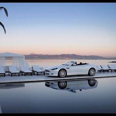 Pure Luxury: White Aston Martin in a gorgeous setting