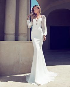 The 2014 Fall/Winter collection of Julie Vino wedding dresses isa direct continuation of designer's unique hallmark of sensual and glamours wedding gowns. Geometric cuts, the feminine silhouettes,transparent and opaque fabrics, these elegantly sexy gowns are perfect for a modern daring bride!