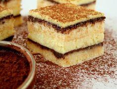 Dwa biszkopty przełożone polewą czekoladową i masą serową… Cudo! Teraz jest w zasięgu Twojej ręki! Ten przepis czeka aż go odkryjesz. Poznaj nowy smak!