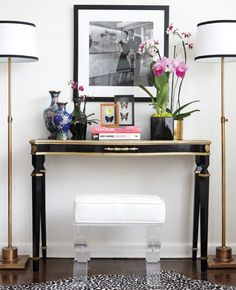 delicate console table balanced by acrylic bench and tall skinny lamps. love the black trimmed Matching Floor Lamps - Black and Gold. and the leopard rug.