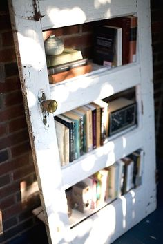 I Love this!!!! old doors/books/storage with charm