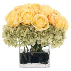 Faux rose and hydrangea arrangement from Natural Decorations, Inc. Made in the USA.   Product: Faux floral arrangementCons...