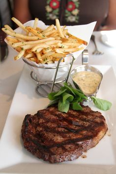 steak frites .. I hope these are Belgian fries and the steak is still red ..
