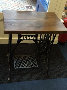 Look at this beauty of a restored Singer table!