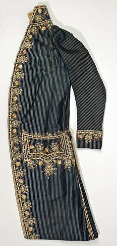 Court suit, France, fourth quarter 18th century. Dark blue and pale blue striped silk, lavishly embroidered with naturalistic flowers in coloured silk.