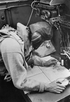 The Royal Air Force: Cecil Beaton photograph of a navigator working at his chart table in an RAF Stirling bomber, 1941.