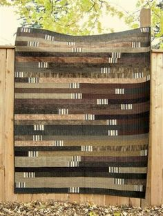 This quilter added a striped block between the strips - very masculine!