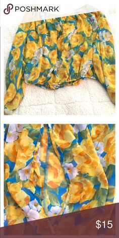Summer Flowered long sleeve blouse. Summer Flowered long sleeve blouse. Has opening in back to show a little bit of back. Can be used lowered to show shoulders(: Tops Blouses