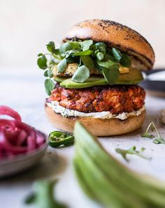 Blackened Salmon Burgers with Herbed Cream Cheese + VIDEO - Half Baked Harvest - - Here's the deal, not only are these salmon burgers healthy and delicious, they're also incredibly easy to prepare. Great Burger Recipes, Best Burger Recipe, Salmon Recipes, Seafood Recipes, Cooking Recipes, Healthy Recipes, Healthy Meals, Delicious Recipes, Easy Recipes