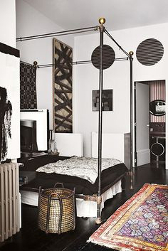 HOME TOUR: A SPANISH PAINTER'S STATELY MASCULINE LOFT Interior designer Lorenzo Castillo gives his artist brother's modern loft a major makeover.