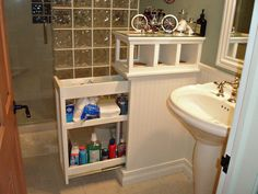 Instead of an empty half wall in a bathroom, install a pull out shelf in it.