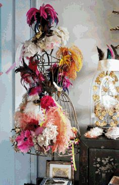 Mannequin with feathers and maybe flowers as centerpieces