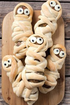 Talk about the perfect Halloween appetizer! This recipe for Sausage Meatball Mummies takes savory sausages wraps them in pizza dough and tops with string cheese eyes to make a dish that all your party guests are sure to enjoy.