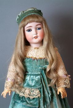 It's not unexpected that the Queen Louise doll could be found in many homes of young Victorian girls back in the day; the pleasant dolly expression,