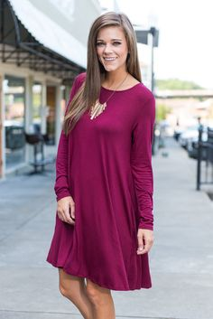 You're going to look like a dime in this pretty shade of plum! The long-sleeve dress is right on trend for fall and oh-so easy to wear. When you go out in this dress you deserve to be wined and dined!  Material has a generous amount of stretch.  Miranda is wearing the small.  Sizes fit: Small- 0-4; Medium- 6-8; Large- 10
