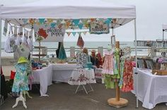 cute craft show set up. must get some blank canvas type of fabric and do some bunting banners