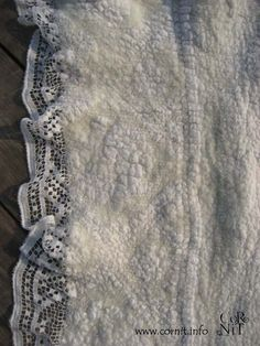 Fantastic texture! Interesting how you can still see the pattern of the lace through the felt.