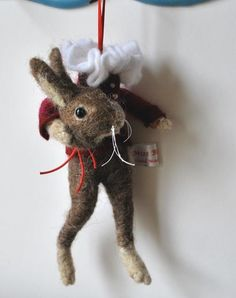 needle felted ornament...why is the poor thing holding his head?
