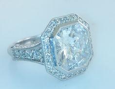 Contemporary Radiant 11+ Carat Diamond Ring Set in Platinum - $180K VALUE