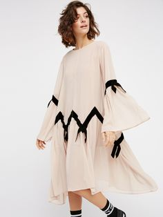 Adalyn Dress | Gorgeous sheer dress with an effortless, oversized shape. Dramatic femme bell sleeves and lovely velvet accents throughout create a darling look. Separate slip included with a stretchy fabrication and adjustable straps for an easy fit.