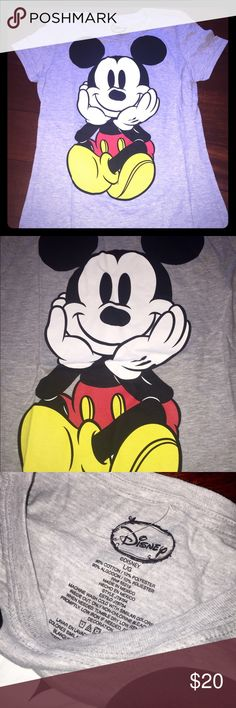 DISNEY MICKEY MOUSE SHIRT BRAND NEW, NEVER WORN!!!  Disney brand.   Grey colored short sleeve t-shirt with Mickey Mouse character print on BOTH the front and back (see pics)  Women's size large (slim fit) Disney Tops Tees - Short Sleeve