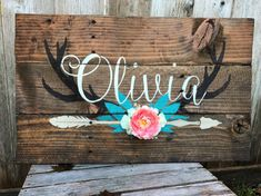 This sign comes with an artificial flower cluster of 7 (1 coral color and 6 small off white roses)silk flowers.  (Feel free to ask for Customization on flowers and colors)  26x16 inches  Leave the following information in the notes to seller section at checkout. Babys Name Any changes to color (if no colors are stated it will come as pictured) .   This custom designed Nursery Name Monogram sign is a great piece for any rustic , boho, shabby chic, or woodland nursery. I custom design each…
