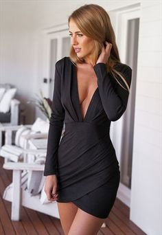 Black Long Sleeved Infinite Nighte Dress with Draped Details Hot INFINITE Dress! Long Sleeves. Front pleat Low V Dress. Stunning Drape Detail. Emboss print/texture detail fabric. Invisible zip.