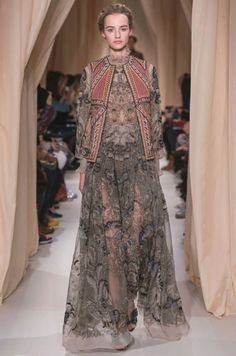 """""""L'Attente sous le bouquet"""", Russian inspired gilet in coral colored cashmere embroidered with soutache and silk threads. Siena muslin dress hand-painted and embroidered with golden and Chagall blue flowers. Valentino Couture, Valentino Gowns, Valentino Women, Haute Couture Style, Couture 2015, Fashion Models, High Fashion, Fashion Show, Vestidos"""