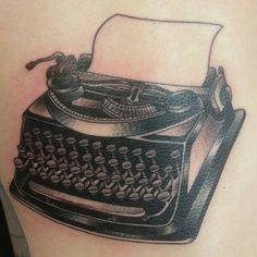 Super fun one from today. A little warped being on his side/back. #tattoo #typewriter #typewritertattoo
