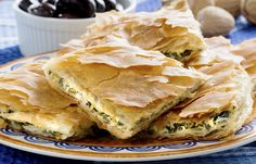 Spanakopita, Greek spinach pie with feta cheese and filo party on on plate with Greek white wine, olives and walnuts Greek Recipes, Pie Recipes, Cooking Recipes, Healthy Recipes, Simple Recipes, Spanakopita Recipe, Greek Spinach Pie, Good Food, Yummy Food