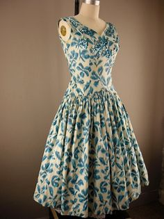 Sweet floral sequin 50s dress. I really really want this!!