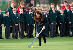 Playing field hockey in heels - love how she matched her outfit to the school uniforms - she's really thoughtful with her clothing choices:)