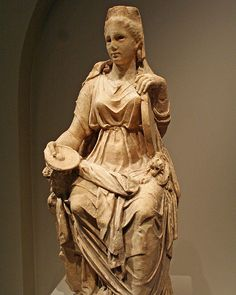 Unknown artist, Statue of Cybele (Roman Marble 1st-2nd centuries).    Cybele, considered one of the most important Roman Goddesses, was the patron of nature and fertility. Attis, the god of vegetation and the consort to Cybele had unmanned himself after realizing that he no longer loved Cybele. She presided over mountains and fortresses; therefore, her crown consists of a city wall.