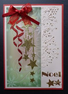 'Noel' card.   Imagination Craft's - Patterned panel card.  Season's greetings stencil.  Stars & ribbon panel stencil.  Gold shine & Bright red Sparkle Mediums.  Metal spatula.Gold Gilt Detail Sparkle.  Memory Nox snowflake die.   July 2014.