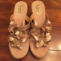 Final $. BORN summer wedges with cork heel. 10 Born wedges for spring & summer in a shimmery beige leather with cork heel. They are mine and oh so comfy and match everything:) they are in great condition! Size 10 Born Shoes Wedges