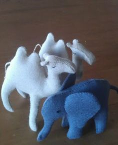 two little camels and an elephant made from felt