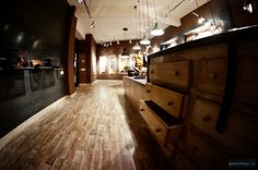 MENHARD STORE IN SIBIU BY GLAMSHOPS Visual Merchandising, Leather Store, Hardwood Floors, Flooring, Retail Space, Store Design, Boutique, Antique Tools, Wood Walls