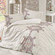 Varela 6-Piece Comforter Set  Create a chic retreat with the soft, light and fresh Varela collection. Featuring beautiful mandala inspired designs and a shimmer of florals, it comes with a fitted sheet in off-white and 4 pillow cases. Also available in a duvet set!