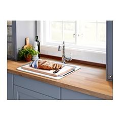 IKEA - DOMSJÖ, Chopping board, Fits in the bowl of DOMSJÖ sink, so you can free up work space, make rinsing easier, and have the water drain directly into the sink.Solid wood is a durable natural material that you can sand and treat the surface as needed.The wood surface is durable yet also gentle on your knives.