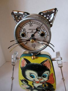 Bitti Kitty Bot - found object robot sculpture assemblage. $150.00, via Etsy.