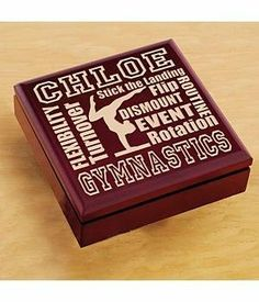 "Personalized Wood Sports Keepsake Box - Gymnastics by Personal Creations. $29.99. A Personal Creations Exclusive! Keepsake Box Has A Cherry Finish And Hinged Cover. Measures 6 3/4""L X 6 3/4""W X 2""D. We Laser Engrave With Any Name, Up To 9 Characters."