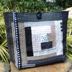 Hand Quilted Linen Patchwork Tote, Sashiko Stitch Handbag, Black Quilted Bag by HobbsHillQuilts on Etsy https://www.etsy.com/listing/464582155/hand-quilted-linen-patchwork-tote