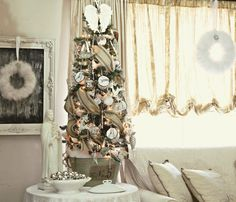 I'm finished decking the halls, well the living room anyway. It's my favorite time of the year. Lets take a little look see shall we? ...