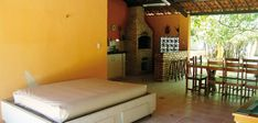 Outdoor but good protected from the sun due to the terrace with a roof. There is a kitchen and a barbecue place! Two bedrooms with double bed and private bathroom with hot water shower and toilet, offer space for up to 4 people!