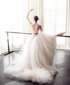 Are you a dancer, why you don't take pictures in the balletroom? it's so beautiful with a white tule wedding dress.