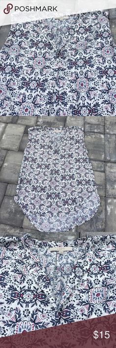 The LOFT high low sleeveless blouse The LOFT high low sleeveless blouse EUC!! Pretty floral print. 100% polyester, has a silky feel to it. V neck. Size small but fits larger. More like a M-L. LOFT Tops Blouses