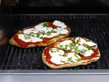 Grilled Pizza - homemade dough & tomato sauce, fresh basil, and mozzarella & parmesan cheese.