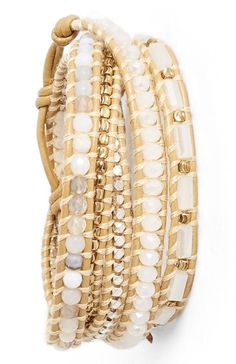 Designed to give the impression of multiple bracelets, this bohemian-chic wrap bracelet is handcrafted from smooth leather, gold details and woven with a mix of luminous semiprecious beads.