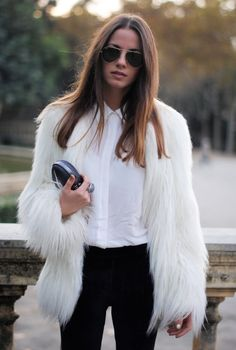 She's definitely making this white fur coat outfit look completely wearable with a classic button up collared shirt and black fitted pants. Super cute!